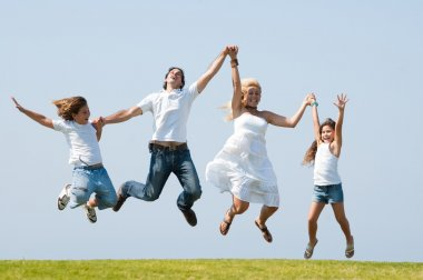 Happy family jumping high