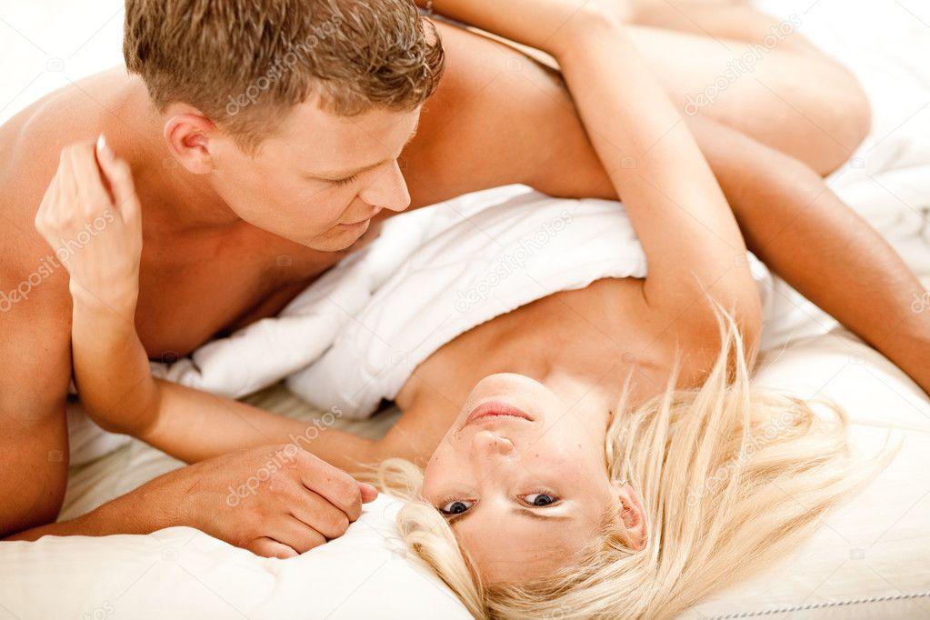 Mid adult couple making love