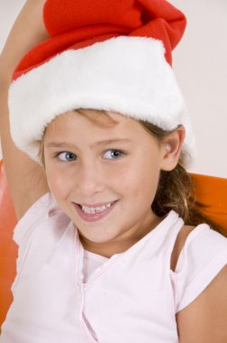 Smiling little girl with christmas hat