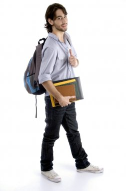 Smart student with his bag and books