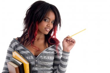 School girl posing with pencil and books