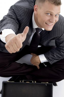 Young businessman with thumbs up