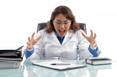 Frustrated doctor in workplace screaming
