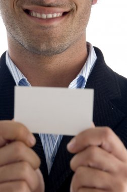Young executive holding business card
