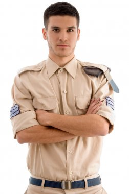 Young american guard with folded hands