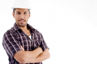Engineer with folded arms, posing