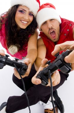 Young loving couple playing video games