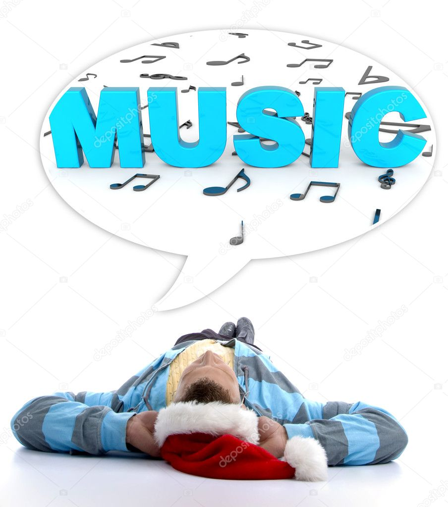 young man thinking of music on floor u2014 stock photo