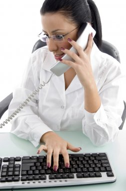 Young woman answering call and working