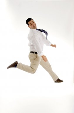 Businessman leaping in mid air