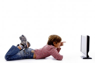 Side pose of boy watching lcd screen