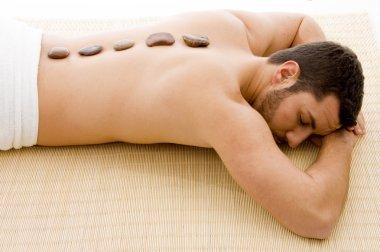 Man lying down on mat at spa