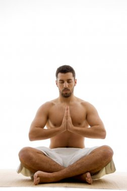 Man practicing yoga with closed eyes