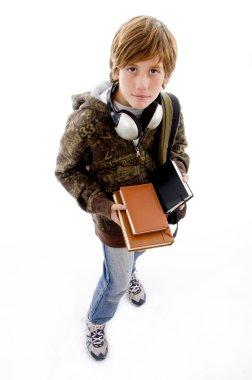 School boy with books and headphones