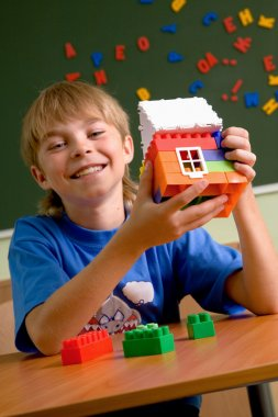 Boy with small house
