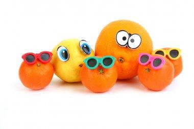 Funny orange, lemon and mandarins