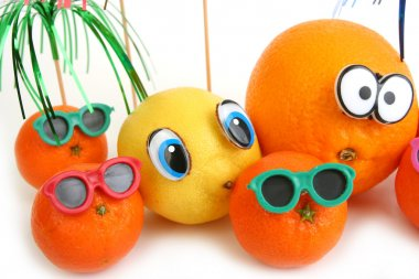 Funny orange, lemon and mandarins
