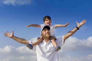Child on man shoulders