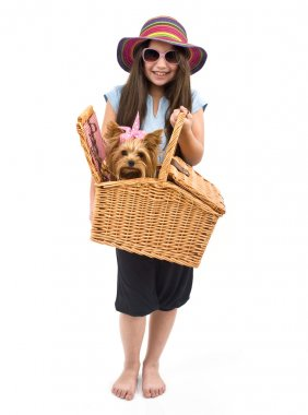 Girl and dog in picnic basket