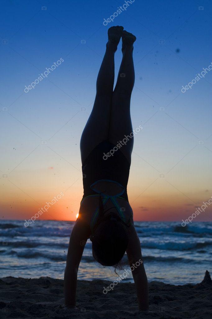 Handstand silhouette beach