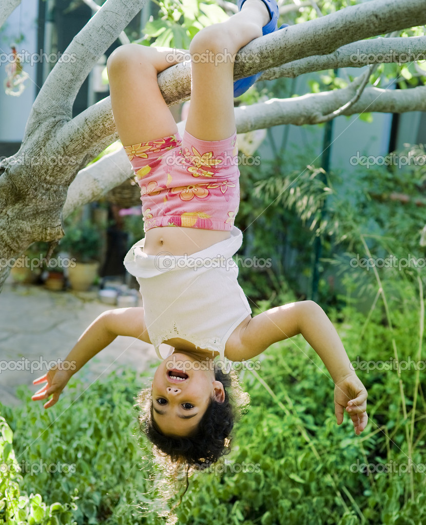 Young girl on tree