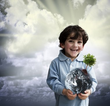 Boy holding world