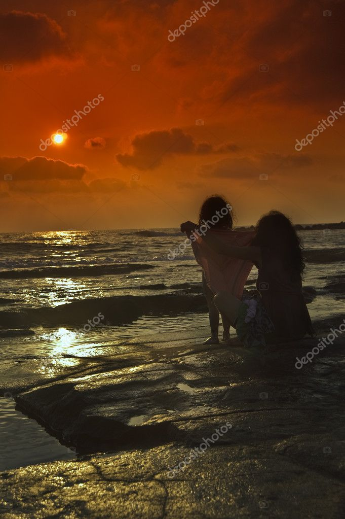 Girl and mother sunset