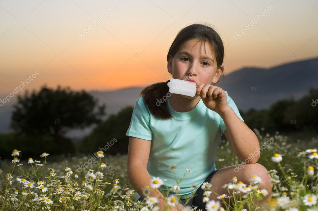 Young girl having a popsicle