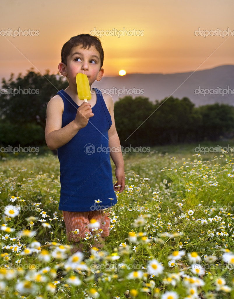 Young boy having an popsicle