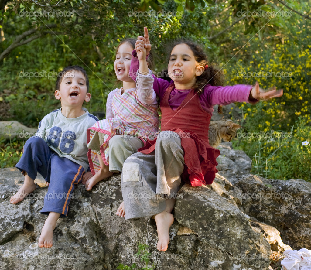 Three kids singing outdoors
