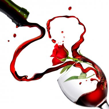 Heart from pouring red wine in goblet