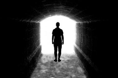 Human silhouette in back lighting