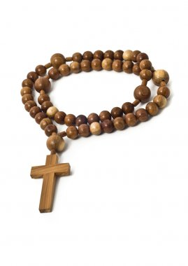 Beads isolated over white with focus on christ