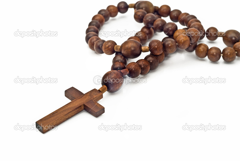 Brown Wooden beads isolated over white with focus on cross (shallow DOF)