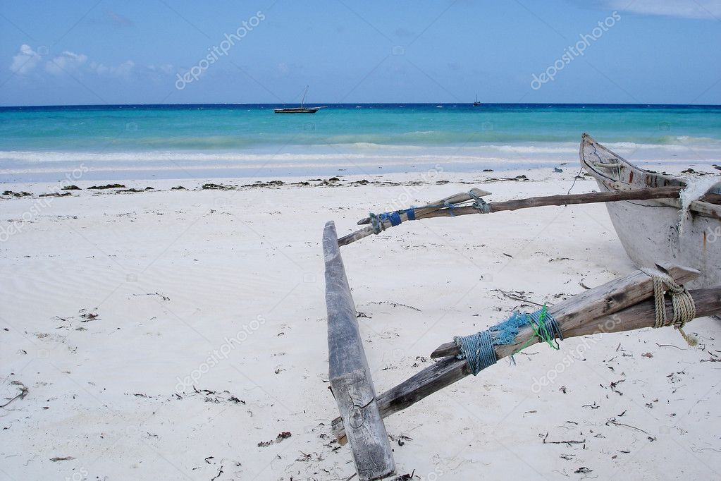 Old dhow on a beach on Zanzibar