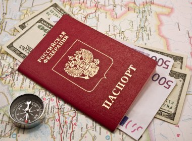 Passport with money on a map,compass