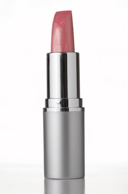 Pink lipstick on white background