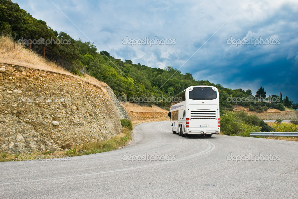 The modern tourist bus on mountain road