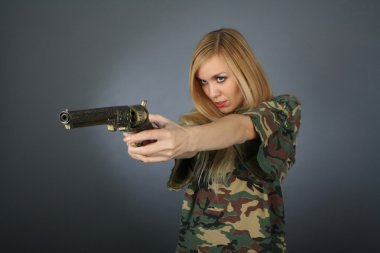 Blonde with a revolver