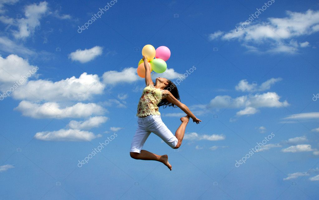 Happy woman flying with balloons
