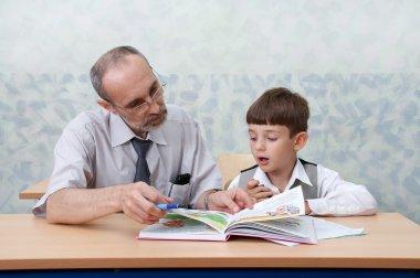 Elementary school. Teacher and schoolboy