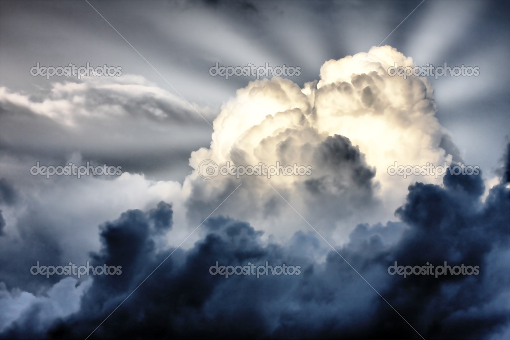 Storm clouds whith sunbeams