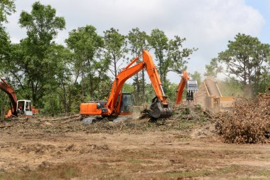 Backhoes Clearing Land