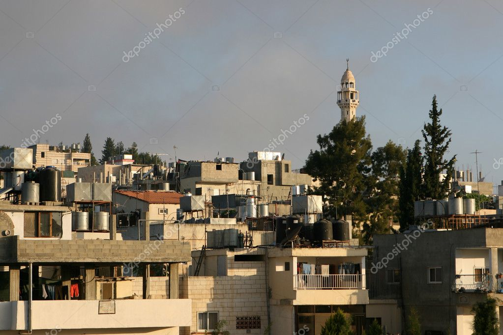 Palestinian homes in Bethlehem with rooftops holding water cisterns.