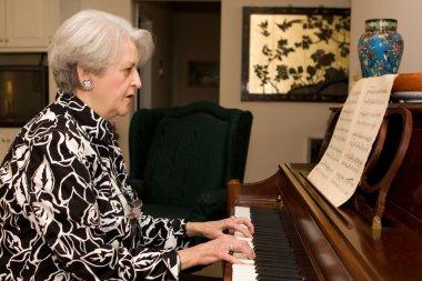 Senior Woman Playing Piano