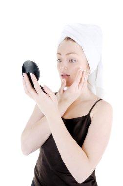 Cream appling on face skin