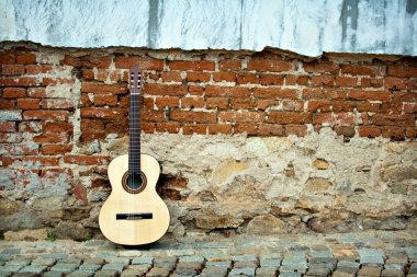 Guitar on old wall