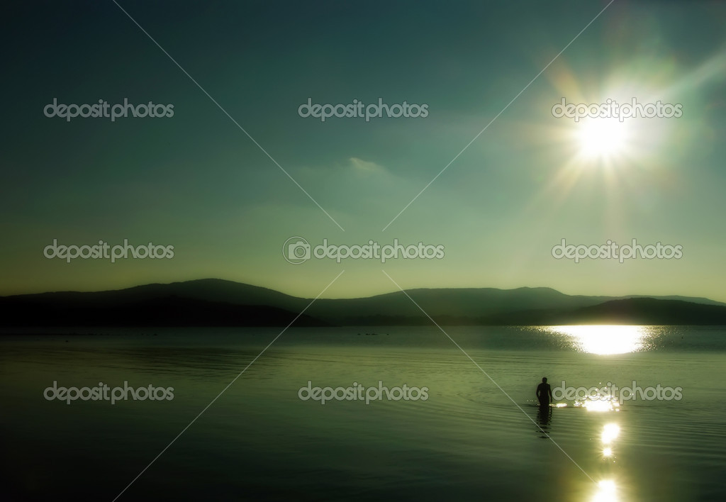 Lonely man walking on the water
