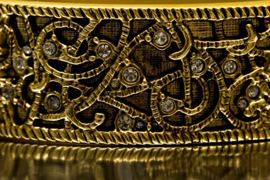 Close-up of gold bracelet with diamonds
