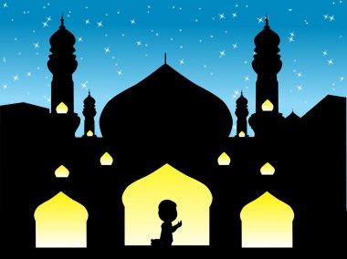A muslim man praying to his god